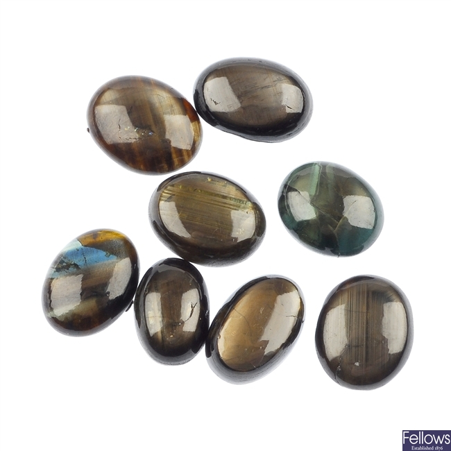 Eight oval star sapphire cabochons.