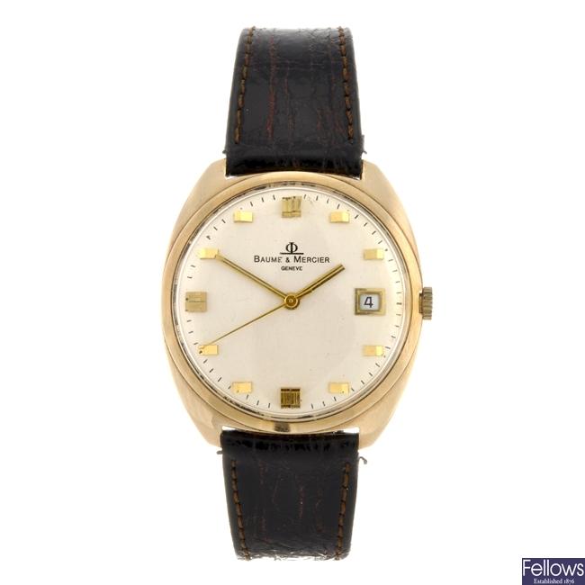 A 14k gold automatic gentleman's Baume & Mercier wrist watch.