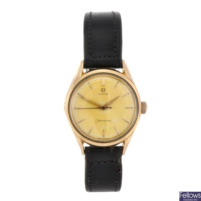 A bi-colour manual wind gentleman's Omega Seamaster wrist watch.
