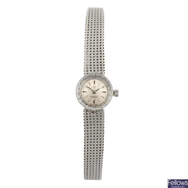 An 18k white gold manual wind lady's Omega bracelet watch.