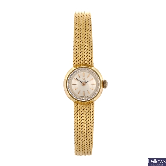 An 18k gold manual wind lady's Omega bracelet watch.