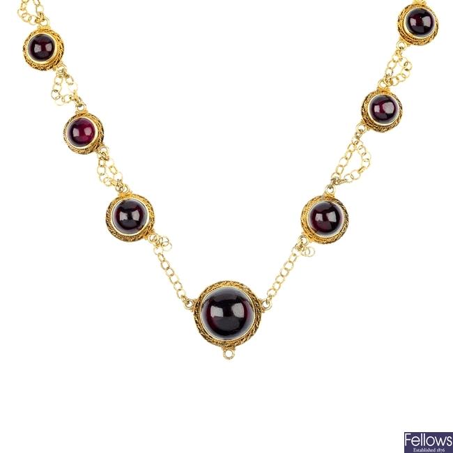 A silver gilt garnet necklace.