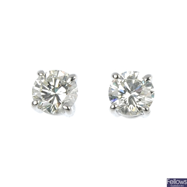 A pair of 18ct gold brilliant-cut diamond single-stone ear studs.