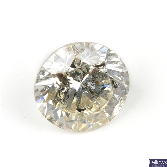 A brilliant-cut diamond, weighing 0.71ct.