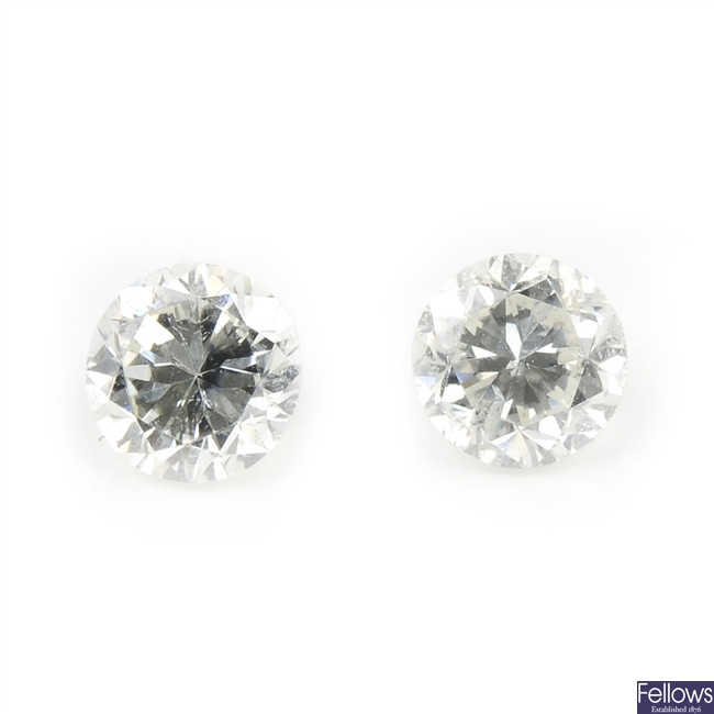 Two brilliant-cut diamonds, weighing 0.37 and 0.35ct.