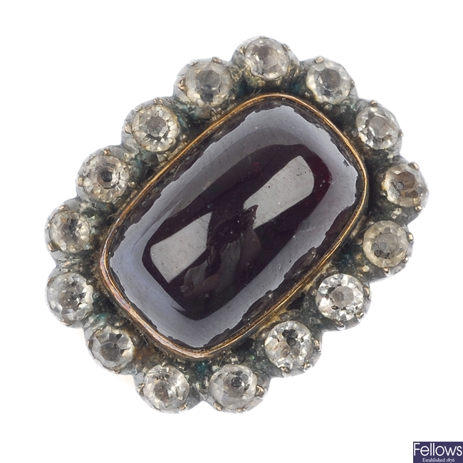 A garnet and paste cluster ring.