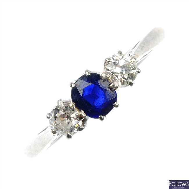 A mid 20th century 18ct gold and platinum sapphire and diamond ring.