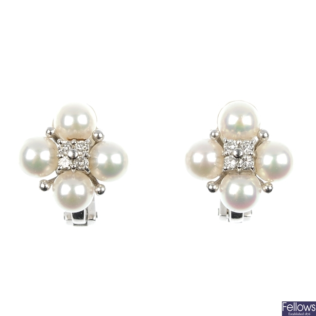 A pair of continental cultured pearl and diamond ear studs.
