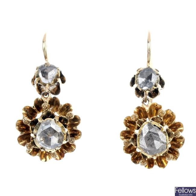 A pair of diamond ear pendants.