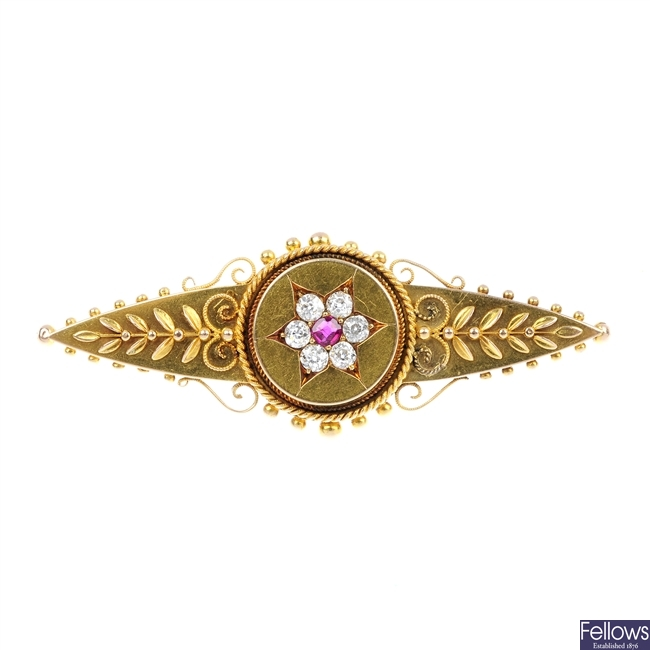 A late 19th century 15ct gold ruby and diamond cluster brooch.