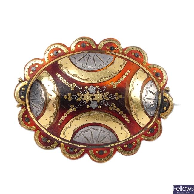 A late 19th century tortoiseshell pique brooch.