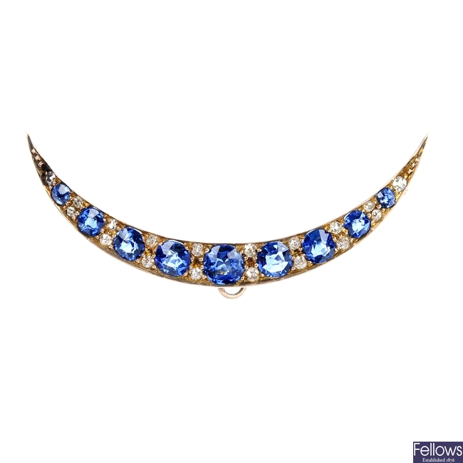 An early 20th century gold sapphire and diamond crescent brooch.