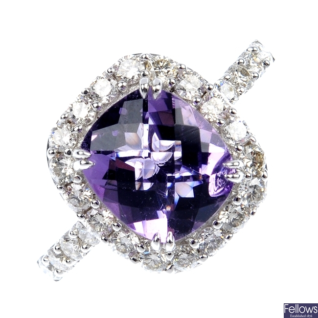 An amethyst and diamond cluster ring.