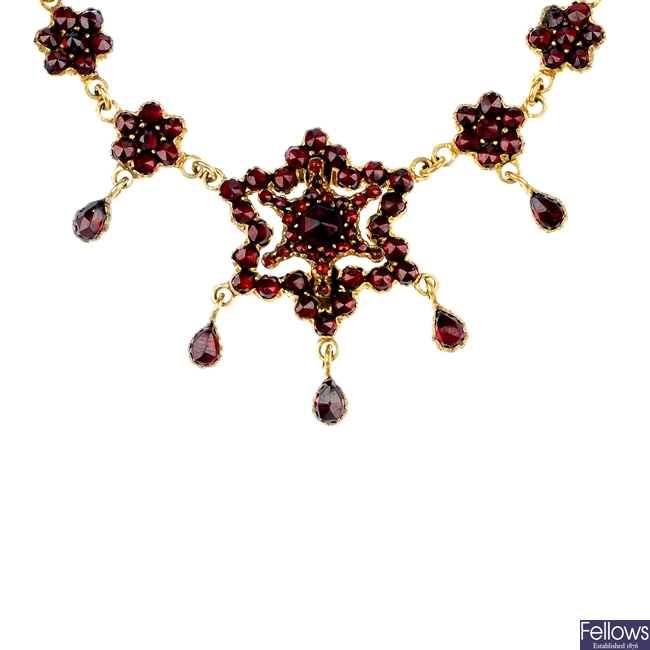 A late 19th century garnet and paste pendant.
