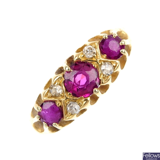 An early 20th century 18ct gold ruby three-stone ring.