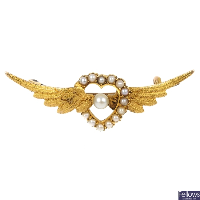 An early 20th century continental gold seed pearl brooch.