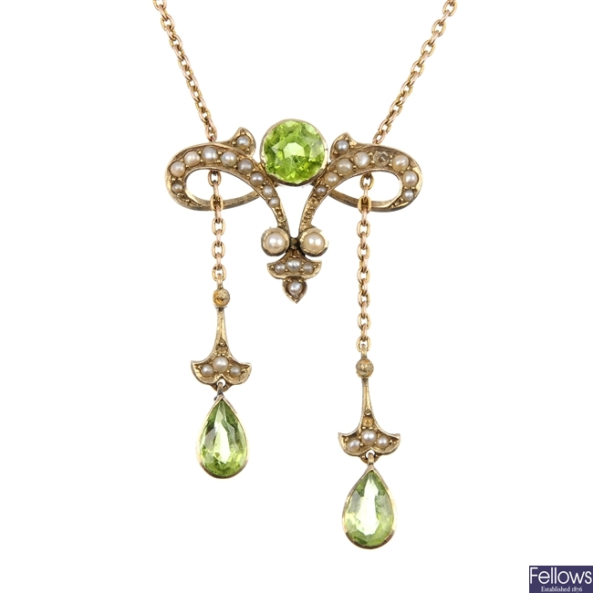 An early 20th century 9ct gold peridot and split pearl pendant.