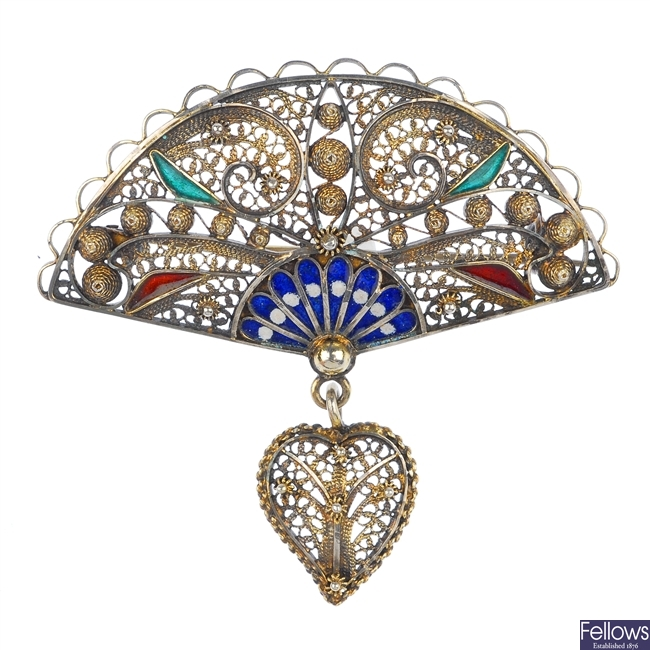A brooch and pendant.