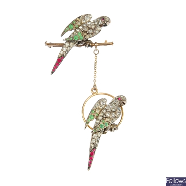 An Art Deco gold and silver gilt paste parrot brooch.
