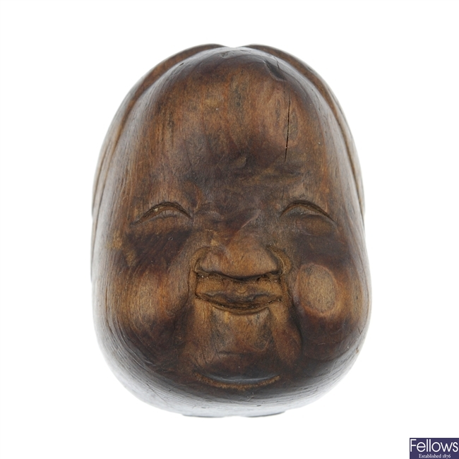 An early 20th century Japanese miniature wooden Noh mask.