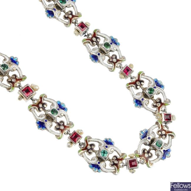 An enamel and gem-set necklace.