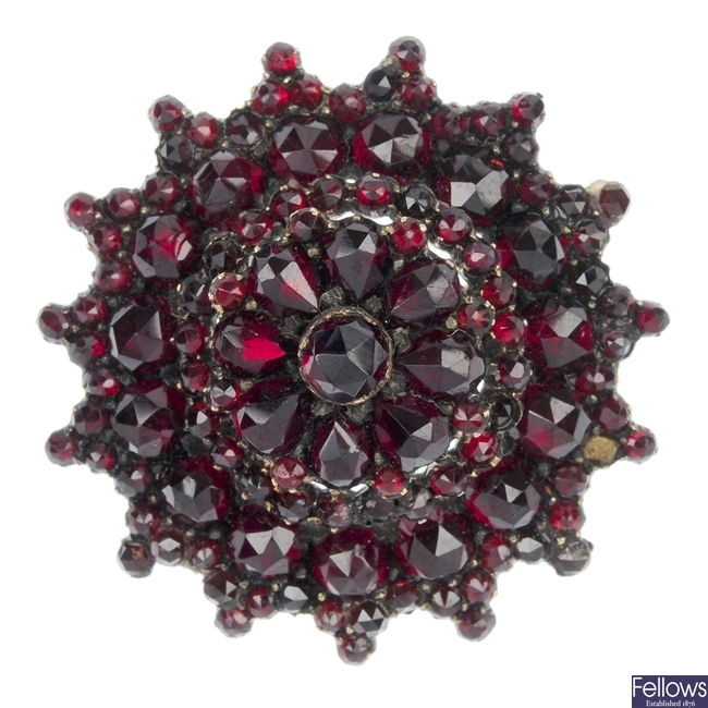 A mid 19th century garnet and paste brooch.