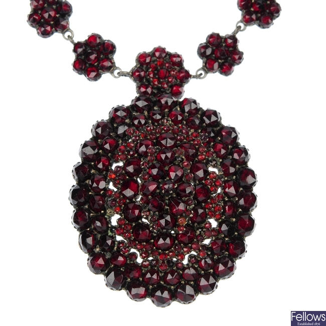 A late 19th century silver garnet and paste necklace.