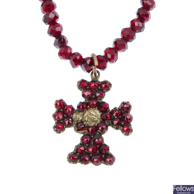 Two early to mid 20th century garnet necklaces.