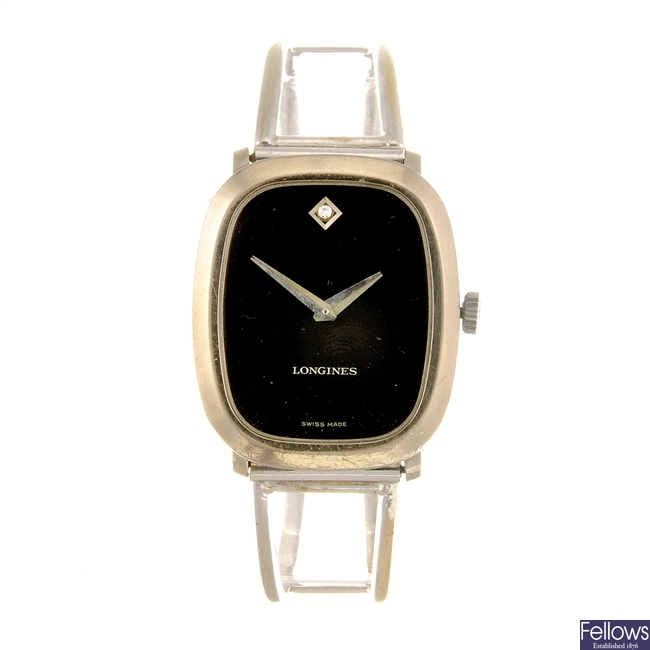 LONGINES - a lady's bangle watch.