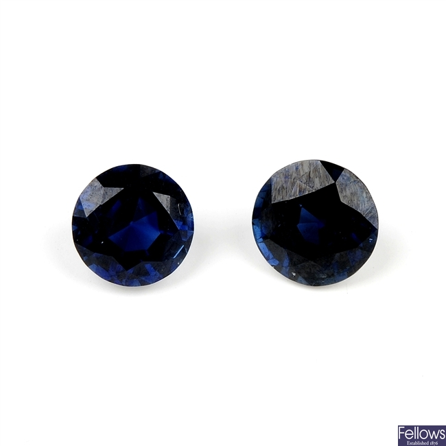 Two circular-shape sapphires, weighing 0.96 and 0.92ct.