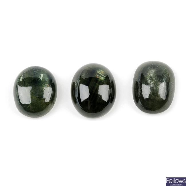 Three green sapphire cabochons.