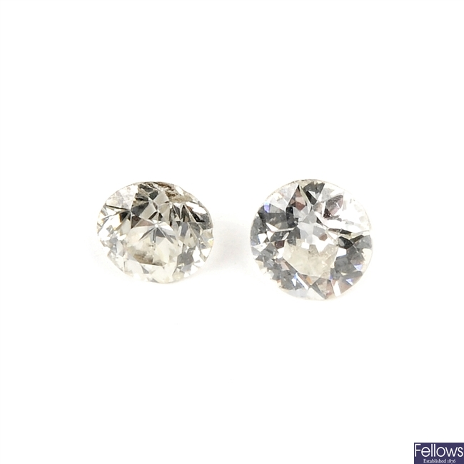 Two old-cut diamonds, each weighing 0.41ct.