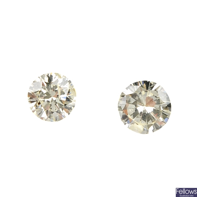 Two brilliant-cut diamonds, weighing 0.38 and 0.35ct.