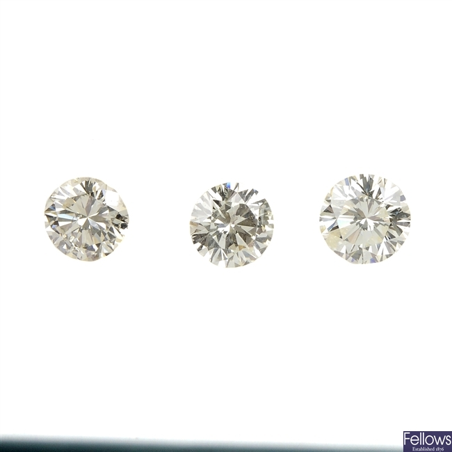 Three brilliant-cut diamonds, weighing 0.43, 0.35 and 0.33ct.