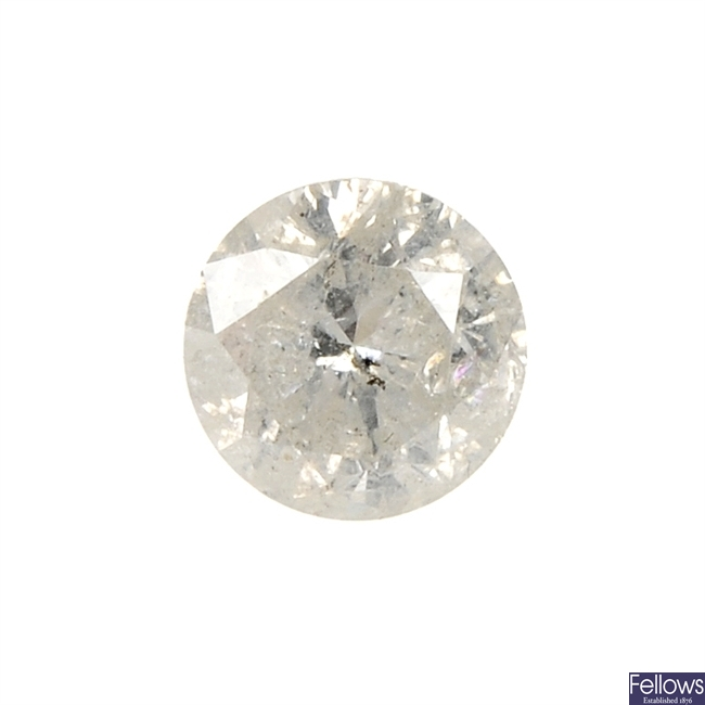 A brilliant-cut diamond, weighing 0.69ct.
