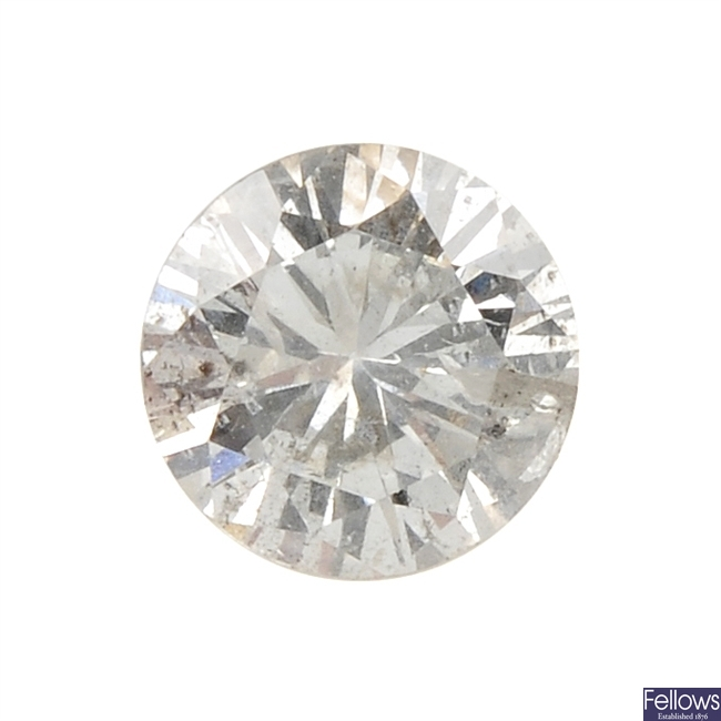 A brilliant-cut diamond, weighing 0.79ct.