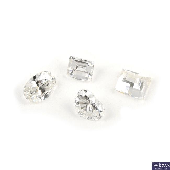 Four vari-cut diamonds.