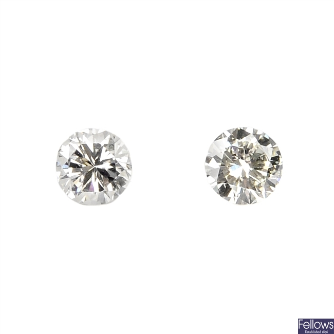 Two brilliant-cut diamonds, weighing 0.29 and 0.25ct.