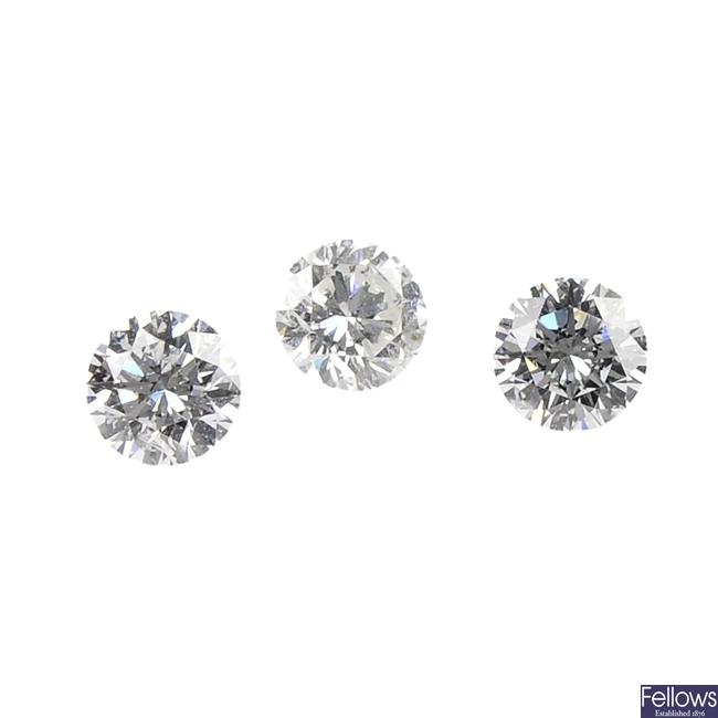 Three brilliant-cut diamonds.