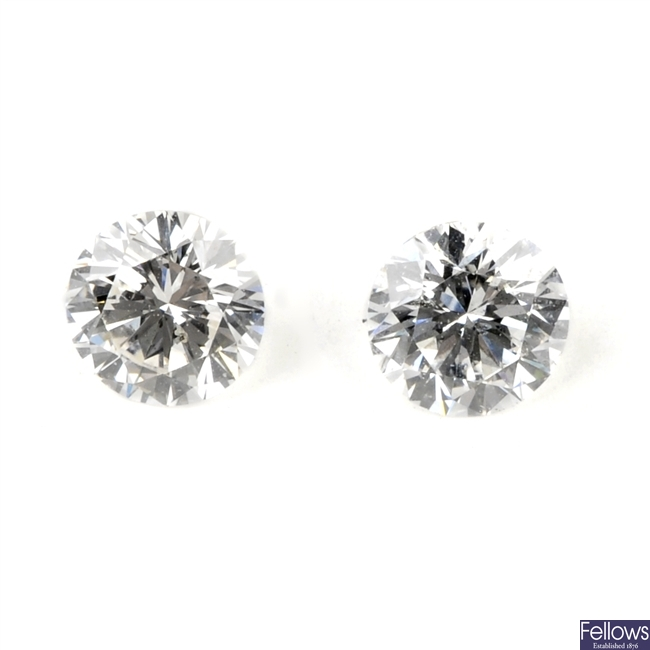 Two brilliant-cut diamonds, weighing 0.33 and 0.31ct.