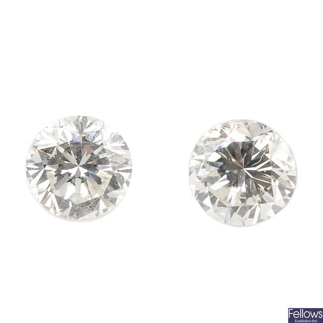 Two brilliant-cut diamonds, weighing 0.37 and 0.34ct.