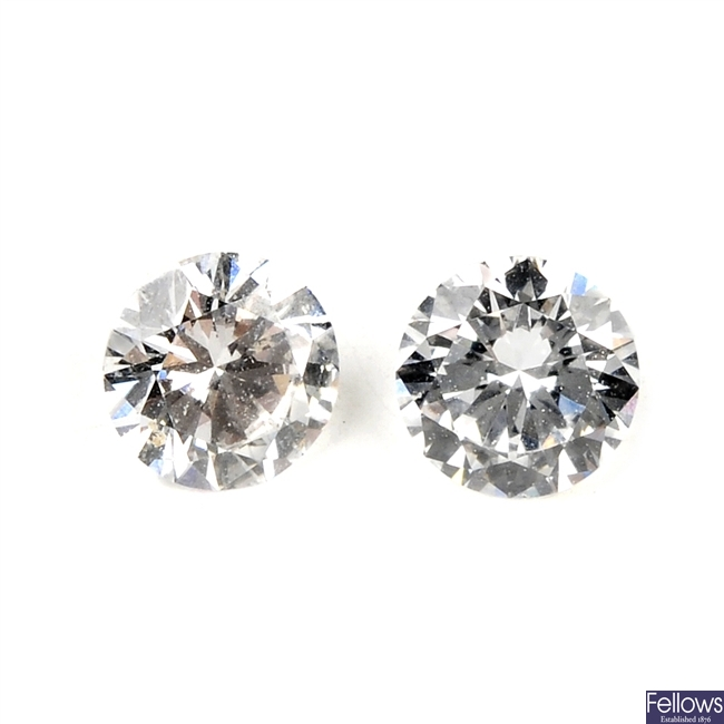 Two brilliant-cut diamonds, weighing 0.29 and 0.27ct.