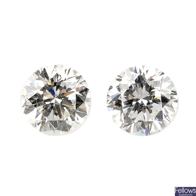 Two brilliant-cut diamonds, each weighing 0.33ct.