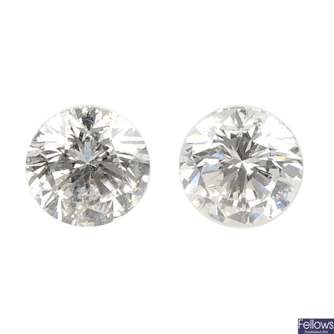 Two brilliant-cut diamonds, weighing 0.33 and 0.32ct.