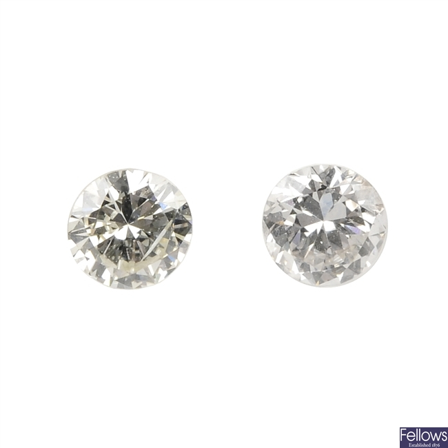 Two brilliant-cut diamonds, weighing 0.29 and 0.28ct.