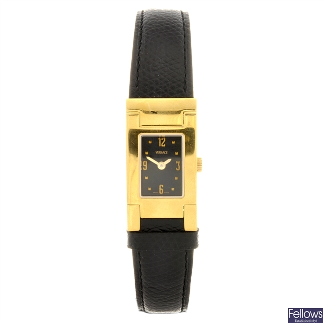 A gold plated quartz lady's Versace wrist watch.