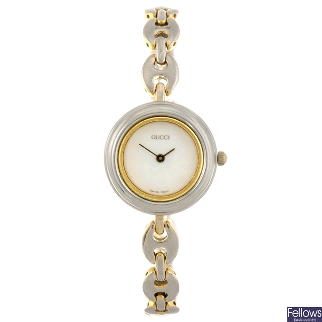 A gold plated quartz lady's Gucci bracelet watch.