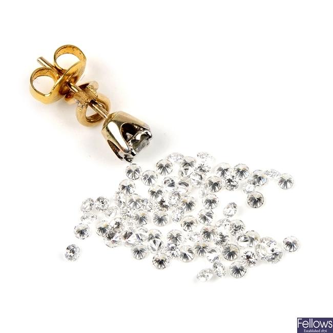 A selection of diamonds and a single ear stud.