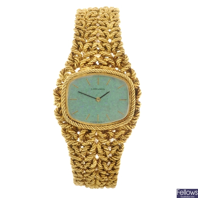 An 18k gold manual wind gentleman's Longines bracelet watch.