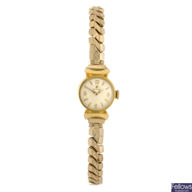 A gold plated manual wind lady's Omega bracelet watch with a Omega watch head.